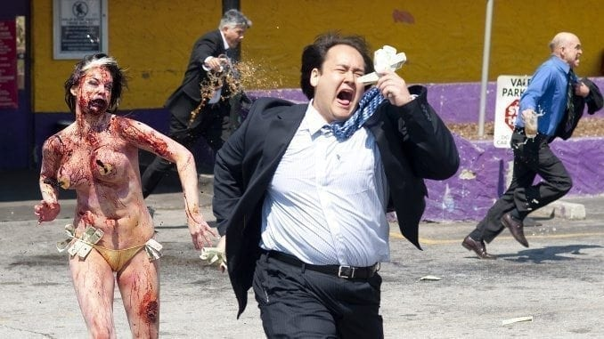 Stripper zombie chasing a patron in Columbia Pictures' comedy ZOMBIELAND. Photography by: Glen Wilson