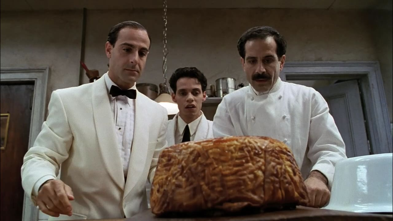 Från filmen Big Night. Tre personer står i ett kök och stirrar på en enorm stek.