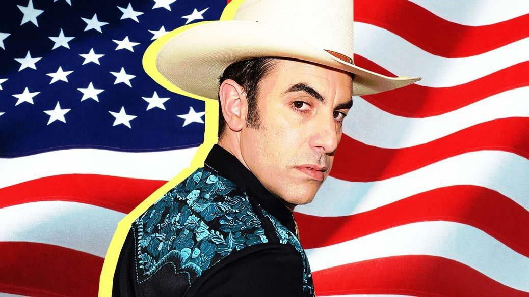Sacha Baron Cohen står framför den amerikanska flaggan i en poster till Who Is America?.