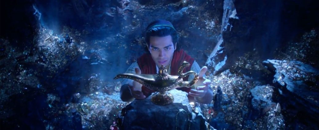 Aladdin sträcker sig efter lampan.