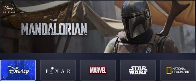 Bild på The Mandalorian och loggor till de företag Disney äger