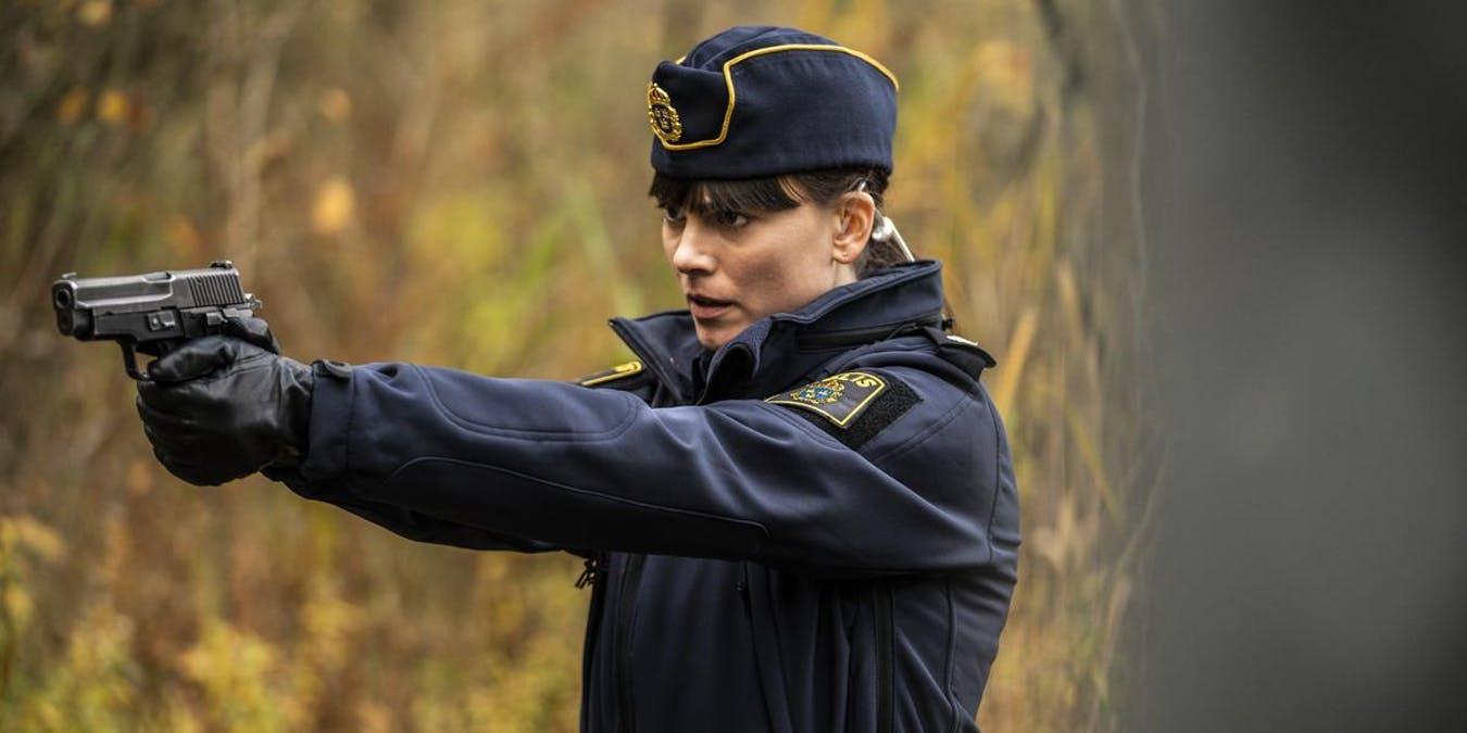 Polisen Huss riktar vapen